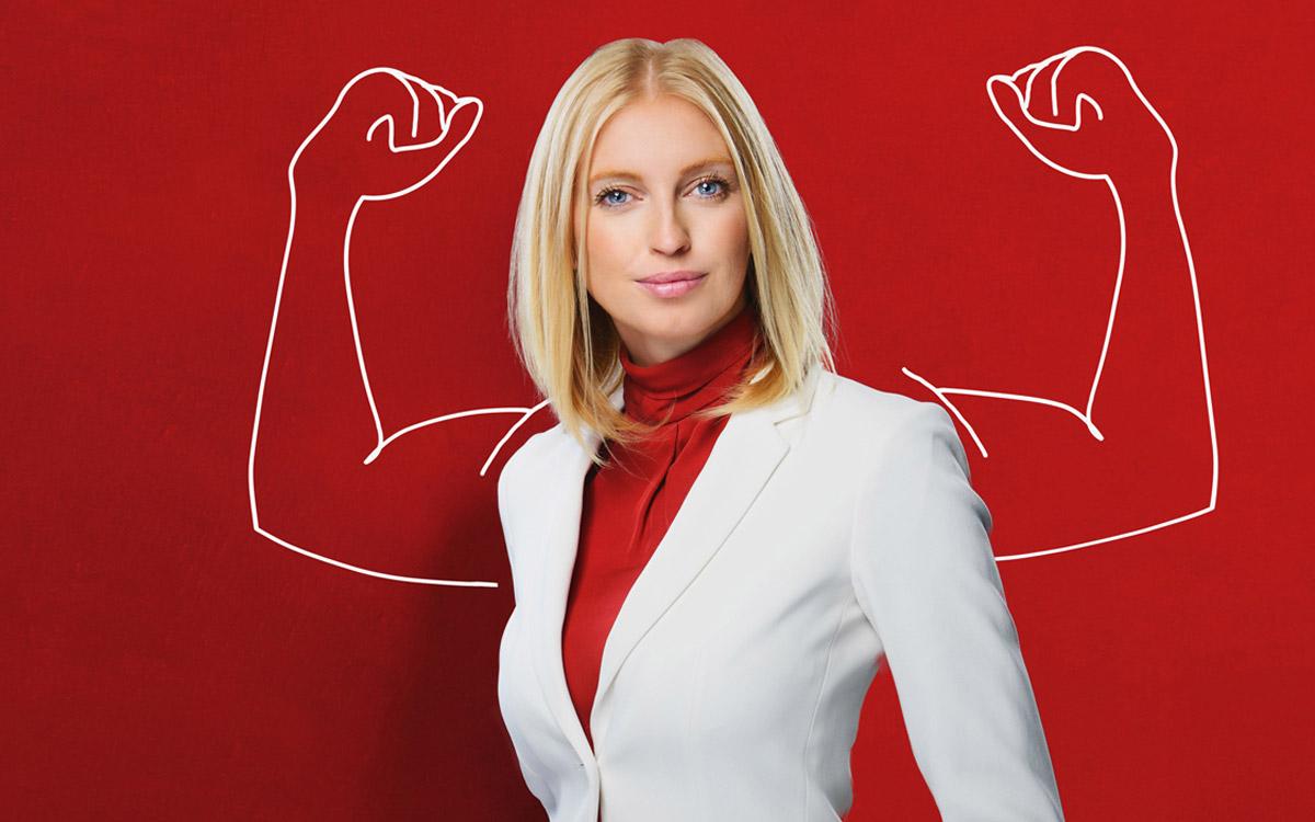 donna bionda con disegno di braccia muscolose Leadership Focus e Linguaggio interno